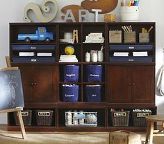 Cute idea for boy room or playroom  Cameron Creativity Storage System with Art Cubbies #pbkids