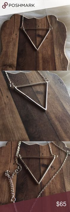 Triangle sterling silver necklace Solid sterling silver 925 chain and pendant. Triangle pendant it's solid sterling silver and it looks gorgeous in person you will not be disappointed it's a really beautiful cute modern design that's in trend 16-17 inches long Triangle shape necklace Imperfect Divine Jewelry Necklaces