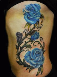 roses on the ribs by Justin Buduo: Tattoo Inspiration - Worlds Best Tattoos Rose Vine Tattoos, Blue Flower Tattoos, Neue Tattoos, Body Art Tattoos, Sleeve Tattoos, Finger Tattoos, Tattoo Drawings, Hand Tattoos, Small Tattoos