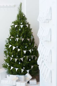 Christmas tree decorated with white pendant flags