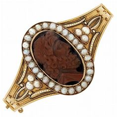 Archaeological Revival Carved Agate Cameo Bangle Bracelet Surrounded And Flanked By Split Pearls, Applied With Black And White Enamel, Edged By Small Gold Beads And Pierced Ribbon Sides    c.1870