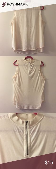 High Neck Sleeveless Ann Taylor LOFT Cream Top Ann Taylor High Neck, Sleeveless Cream top. Made for layering since fabric is very light. Zipper closure in the back and neck is made of a stiffer rayon. Entire Top is 100% rayon. Never worn just washed once. Ann Taylor Tops