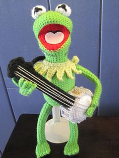 Hi-Ho! This pattern is 9 pages of fully-colored illustrations, everything you need to make Kermit and his Banjo. It's not easy being green, but it IS easy to make your own Kermit.