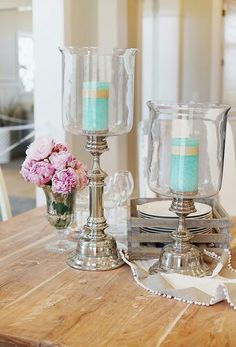 Glue silver candlesticks and straight side vases together for inexpensive version of these