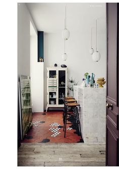 I love the contrasting finishes - tile/wood/marble. Floor magazine/ Jean-Christophe Aumas apartment/ (c) Urban Zintel