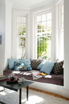 Bay window, window seat, feels more like a sofa. Cozy and a nice place to read) ♥