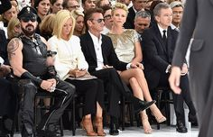 Lovers Charlize Theron and Sean Penn electrify Dior's couture show, as fashion gets political