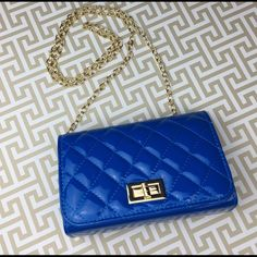 Cobalt Blue Quilted Patent Bag w/ gold accent NEW Cobalt Blue handbag, use as cross-body or clutch. Please view last photo for minor defects on the gold clutch turn. Non-smoke environment. Lil+Lo ~ NEW 🚫NO TRADES🚫 🎀Discounts with bundles only🎀 Lil + Lo Bags