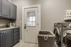 Traditional Laundry Room with travertine floors, Built-in bookshelf, High ceiling