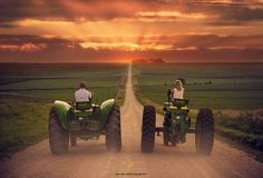 Two John Deere's driving down a country road