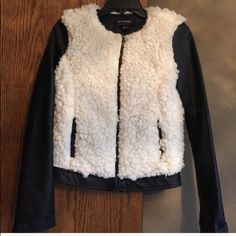 """Faux leather & shearling jacket Black faux leather and cream shearling fur jacket. Softest thing I've ever felt! Full front zip, 2 front pockets. Purchased but never worn. No flaws. Size S. Approx measurements flat: top of shoulder to hem 22"""", armpit to armpit 18"""", seam of shoulder to cuff of sleeve 24"""". Materials listed in photo 4. Please ask any questions prior to purchasing. Thank you! Coffee Shop Jackets & Coats"""