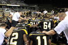 Former Appalachian State University coach Jerry Moore: DON'T PASS ON CHRIST - A popular football coach recently returned to campus with a MY Hope video in hand to share his faith & encourage the team not to play with eternity. - Coaches and players from the Appalachian State University football team gather for prayer.