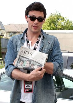 Cory showing that his band, Bonnie Dune is in the Arts section of the newspaper.