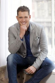 He's a cutie who loves his family, is crazy about his wife, sings standards and terrific original compositions, and loves hockey.  What's not to love about Michael Buble?