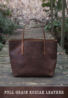It ends here - the search for the THE perfect leather tote. Made with full grain kodiak leather, it's weatherproof and durable in addition to being beautifully crafted. You'll want this purse by your side every day; don't be afraid to load it with anything you might need. Laptop, makeup, paperbacks, sunnies, they'll all dig the new space.