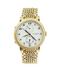 Lot 236 A Patek Philippe 18k gold travel time wrist watch 2004 http://www.colasantiaste.com/?language=en