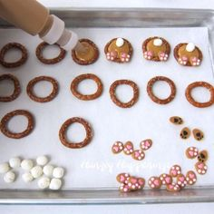 Pour peanut butter candy melts into pretzel rings then add a marshmallow tail and bunny feet to make cute Bunny Butt Pretzels.