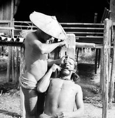 1938. Chiseling teeth, Mentawai islands Indonesia. Source: Museum Volkenkunde Leiden Holland.