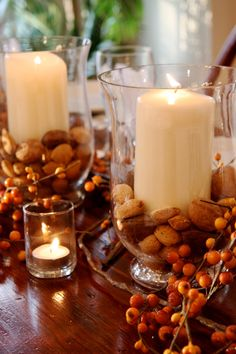 With cranberries and nuts painted gold with vases or platters from Home Goods!!! -bk
