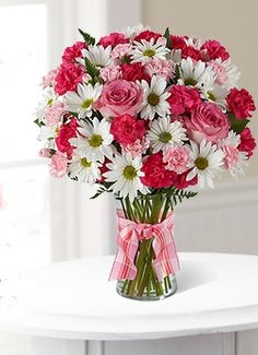 Sweet Surprise Sending a Sweet Surprises Bouquet is an absolutely charming way to send your warmest sentiments. Pink mini carnations, hot pink rose stems, white traditional daisies and lush greens are sweetly situated in a classic clear vase accented with a perfectly pink designer ribbon to create a bouquet that will delight your special recipient at every turn. $39.99 Order Now! www.pinehurstfloral.com