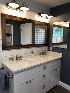The Lane of Lenore Shiplap Large Mirror is a great addition to any bathroom, entryway, office, bedroom or living room or anywhere you can use some rustic style. Our frame is expertly hand build with unique character, we distress each… Continue Reading → Bathroom Renos, Bathroom Renovations, Home Remodeling, Bathroom Vanities, Bathroom Mirror Makeover, Farmhouse Bathroom Mirrors, Framing Mirror In Bathroom, Bathroom Lights Over Mirror, White Bathroom Cabinets