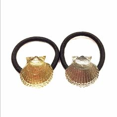 Hair ties Pair of ponytail holders. Seashell shape w/elastic band. Price is for both.new and never worn. Accessories Hair Accessories