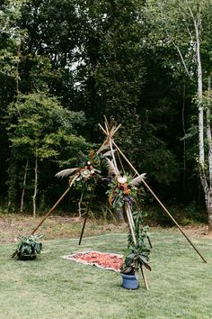 We love this tipi frame decked in bright + colorful floral   Image by Kelly Gin Photography