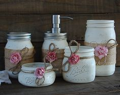 Rustic mason jar desk set. Hand painted in aqua, lightly distressed, tied with jute and ivory colored roses, finished with a protective coating. Set of 3. Accessorize your desk with a place to keep pencils, pens, scissors, business cards and everything organized! Do not immerse in water, clean with a damp cloth. The jars range in height from 5.12 to 2 tall and 3.75 to 3 in diameter. ****More mason jars https://www.etsy.com/shop/TheVintageArtistry?section_id=1375454...