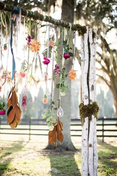 Boho wedding ceremony decor - branch arch with hanging flowers and feathers {Simply Roses}