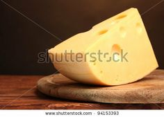 ?heese on wooden board in the room - stock photo