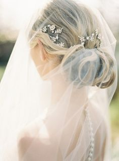This very simple up-do and veil are complimented by the rhinestone hair accessories adding just the right amount of sparkle. #Bride #Veil