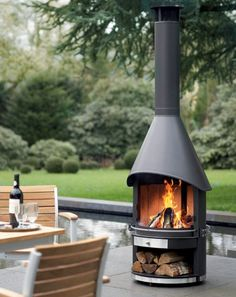 A black-varnished stainless steel Garden Fireplace with a double-sided hood and a wide opening. Outdoor Rooms, Outdoor Gardens, Outdoor Living, Outdoor Decor, Chimnea Outdoor, Parrilla Exterior, Outdoor Heaters, Outdoor Heating Ideas, Fireplace Garden