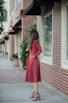 a figure flattering dress and heeled ankle boots make for a perfect date night look