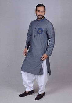 Here is the latest Pakistani men kurta shalwar kameez designs by top Pakistani designers. All of latest men kurta design for men are shown with pictures. Gents Kurta Design, Boys Kurta Design, Designer Suits For Men, Designer Clothes For Men, Pathani Kurta Men, Mens Suits Online, Men Online, Man Dress Design, Shalwar Kameez Pakistani