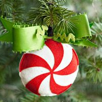 Create a Simple Peppermint Swirl Ornament Homes and Gardens: Add this merry mint ornament to your holiday decor using inexpensive supplies. Diy Felt Christmas Tree, Beautiful Christmas Trees, Noel Christmas, Homemade Christmas, Christmas Candy, Christmas Colors, Christmas Christmas, Diy Christmas Ornaments, Holiday Crafts