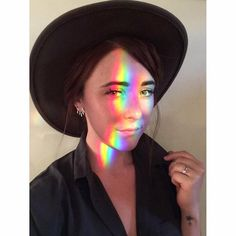 """""""LISTEN, sometimes there's a rainbow on your face and you're really digging your fave hat and earrings and new silk shirt and so you just roll with it,…"""""""