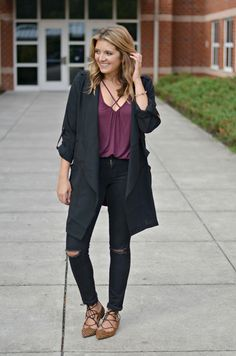 cute fall outfit - crisscross tee with long black draped jacket, black skinny jeans, cheetah print flats | www.fizzandfrosting.com