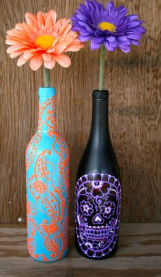 Hand Painted Wine bottle Vase, Up Cycled, Turquoise and Coral Orange, Vibrant Henna style design. $25.00, via Etsy.
