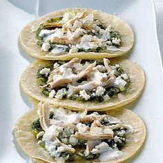 Soft Fried Tortillas with Tomatillo Salsa and Chicken Recipe with tomatillos, serrano chile, white onion, garlic cloves, salt, water, vegetable oil, chopped cilantro fresh, vegetable oil, corn tortillas, cooked chicken, crema, white onion, queso fresco