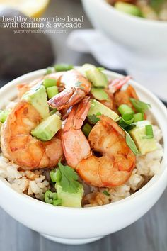 Healthy Brown Rice Bowl with Shrimp & Avocado with a delicious sauce - a light and easy dinner that will satisfy and taste great! via @jennikolaus