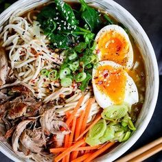 Spicy Pork Ramen noodle soup - Slow cooked pork with noodles, veggies and a just-slightly-runny egg. Full of that delicious umami flavour!