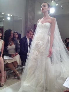 Reem Acra's gown with full body veil caused quite a stir on Saturday at #bridalmarket 2012 | via Bergdorf Goodman Facebook feed