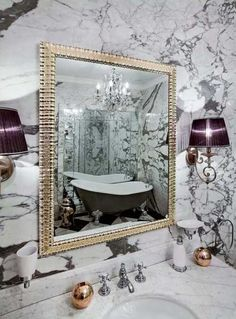 marble bathroom sink countertop and wall mirror in golden frame