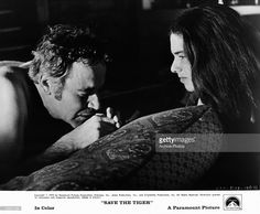Jack Lemmon shares a tender moment with hitch hiker Laurie Heineman in a scene from the film 'Save The Tiger', 1973.