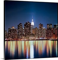 Premium Thick-Wrap Canvas Wall Art Print entitled Reflection of skyline at night, New York, USA., None