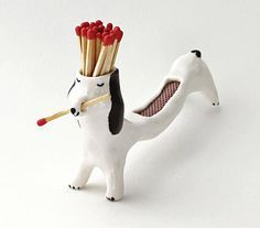 Matchstick Dog Holds Your Matches and Allows You To Strike Them On Its Back