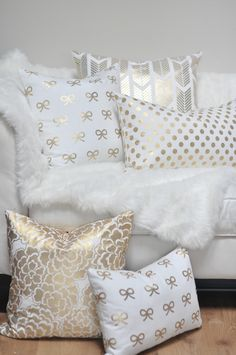 5 shimmery, silver & gold pillows is a little much, but maybe one or 2 would be cute. Plus, i love the fuzzy white blankie.