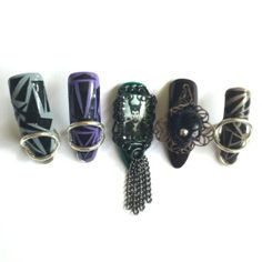 Completed left hand. #BellaGemaNails   I designed these based on the inspiration of the #MALEFICENT TRAILER. Made of solid colors with #ducktape pattern. Rings are .925 silver. Used pewter metal chain accents and Hematite #Swarovski #crystals.    These #nails stand straight up on their tips. The placement of each one of the silver rings serves as a kick stand for each nail. These are just show pieces, not for actual for use.    Right hand and full set images of this design to follow shortly…