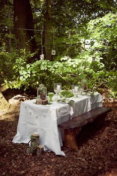 cute!  I like the white table cloth with the green foliage