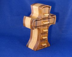 My Old Rugged Cross Band Saw Jewelry Box Has Five Regular Drawers and A Hidden Drawer For Your Special Jewelry Items.